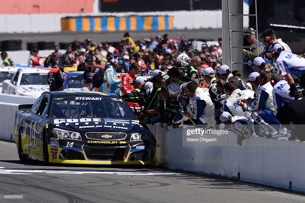 <a gi-track='captionPersonalityLinkClicked' href=/galleries/search?phrase=Tony+Stewart+-+Race+Car+Driver&family=editorial&specificpeople=201686 ng-click='$event.stopPropagation()'>Tony Stewart</a>, driver of the #14 Code 3 Assoc/Mobil 1 Chevrolet, celebrates with his crew after winning the NASCAR Sprint Cup Series Toyota/Save Mart 350 at Sonoma Raceway on June 26, 2016 in Sonoma, California.