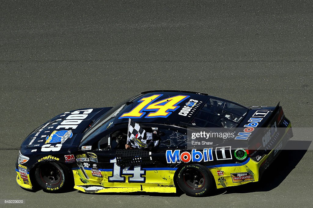 <a gi-track='captionPersonalityLinkClicked' href=/galleries/search?phrase=Tony+Stewart+-+Race+Car+Driver&family=editorial&specificpeople=201686 ng-click='$event.stopPropagation()'>Tony Stewart</a>, driver of the #14 Code 3 Assoc/Mobil 1 Chevrolet, celebrates with the checkered flag after winning the NASCAR Sprint Cup Series Toyota/Save Mart 350 at Sonoma Raceway on June 26, 2016 in Sonoma, California.