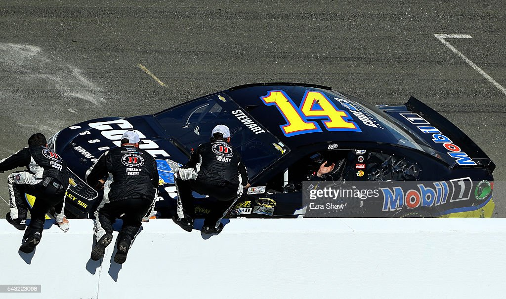 <a gi-track='captionPersonalityLinkClicked' href=/galleries/search?phrase=Tony+Stewart+-+Race+Car+Driver&family=editorial&specificpeople=201686 ng-click='$event.stopPropagation()'>Tony Stewart</a>, driver of the #14 Code 3 Assoc/Mobil 1 Chevrolet, celebrates with team members after winning the NASCAR Sprint Cup Series Toyota/Save Mart 350 at Sonoma Raceway on June 26, 2016 in Sonoma, California.