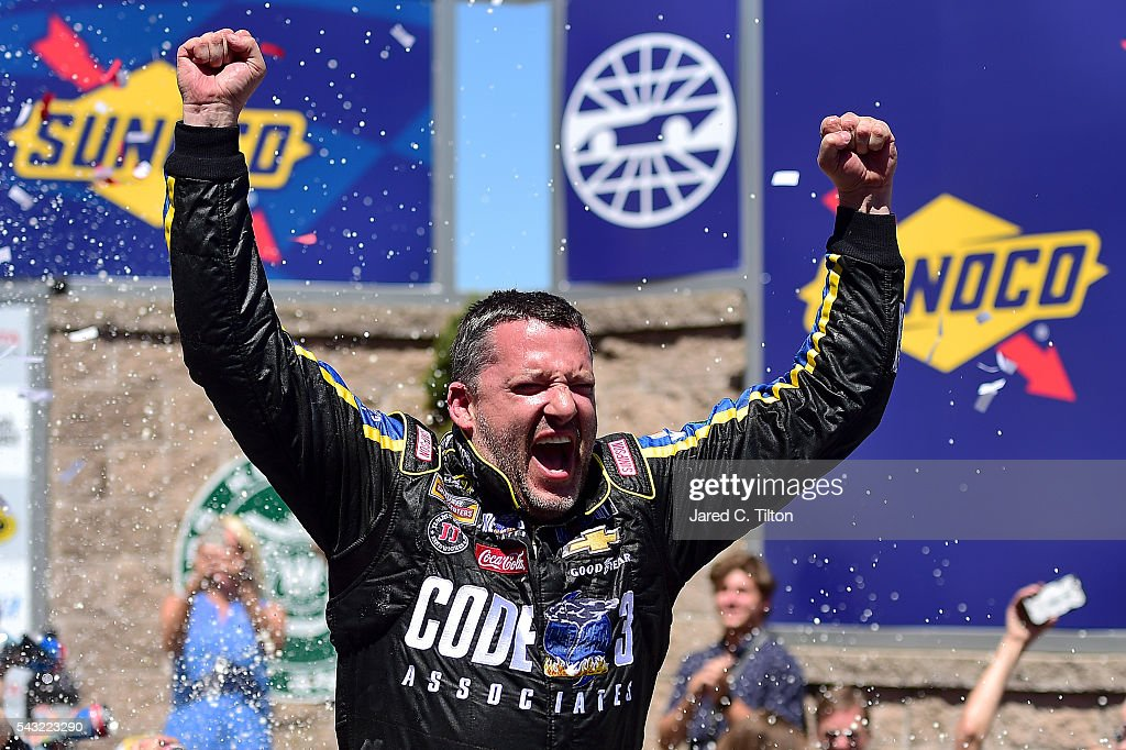 <a gi-track='captionPersonalityLinkClicked' href=/galleries/search?phrase=Tony+Stewart+-+Race+Car+Driver&family=editorial&specificpeople=201686 ng-click='$event.stopPropagation()'>Tony Stewart</a>, driver of the #14 Code 3 Assoc/Mobil 1 Chevrolet, celebrates in victory lane after winning the NASCAR Sprint Cup Series Toyota/Save Mart 350 at Sonoma Raceway on June 26, 2016 in Sonoma, California.