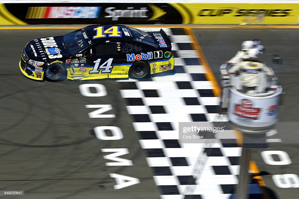 <a gi-track='captionPersonalityLinkClicked' href=/galleries/search?phrase=Tony+Stewart+-+Race+Car+Driver&family=editorial&specificpeople=201686 ng-click='$event.stopPropagation()'>Tony Stewart</a>, driver of the #14 Code 3 Assoc/Mobil 1 Chevrolet, crosses the finish line to win the NASCAR Sprint Cup Series Toyota/Save Mart 350 at Sonoma Raceway on June 26, 2016 in Sonoma, California.