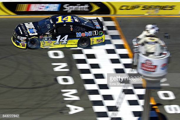 Tony Stewart driver of the Code 3 Assoc/Mobil 1 Chevrolet crosses the finish line to win the NASCAR Sprint Cup Series Toyota/Save Mart 350 at Sonoma...