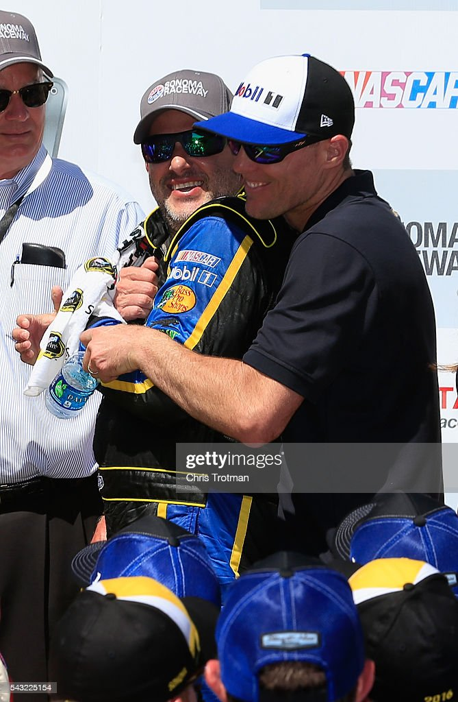 <a gi-track='captionPersonalityLinkClicked' href=/galleries/search?phrase=Tony+Stewart+-+Race+Car+Driver&family=editorial&specificpeople=201686 ng-click='$event.stopPropagation()'>Tony Stewart</a>, driver of the #14 Code 3 Assoc/Mobil 1 Chevrolet, is congratulated by teammate <a gi-track='captionPersonalityLinkClicked' href=/galleries/search?phrase=Kevin+Harvick&family=editorial&specificpeople=209186 ng-click='$event.stopPropagation()'>Kevin Harvick</a>, driver of the #4 Mobil 1 Chevrolet, after Stewart won the NASCAR Sprint Cup Series Toyota/Save Mart 350 at Sonoma Raceway on June 26, 2016 in Sonoma, California.