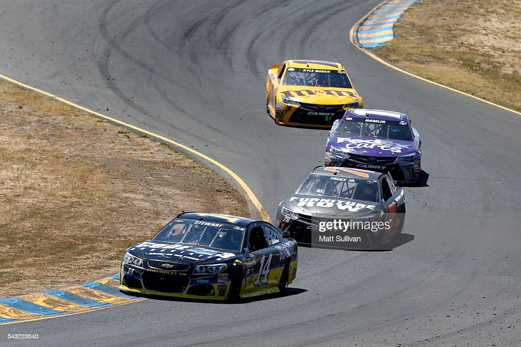 <a gi-track='captionPersonalityLinkClicked' href=/galleries/search?phrase=Tony+Stewart+-+Race+Car+Driver&family=editorial&specificpeople=201686 ng-click='$event.stopPropagation()'>Tony Stewart</a>, driver of the #14 Code 3 Assoc/Mobil 1 Chevrolet, leads a pack of cars during the NASCAR Sprint Cup Series Toyota/Save Mart 350 at Sonoma Raceway on June 26, 2016 in Sonoma, California.