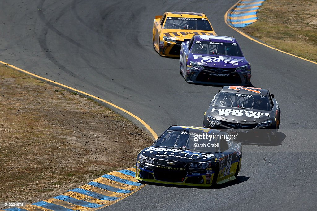Tony Stewart, driver of the #14 Code 3 Assoc/Mobil 1 Chevrolet, leads a pack of cars during the NASCAR Sprint Cup Series Toyota/Save Mart 350 at Sonoma Raceway on June 26, 2016 in Sonoma, California.