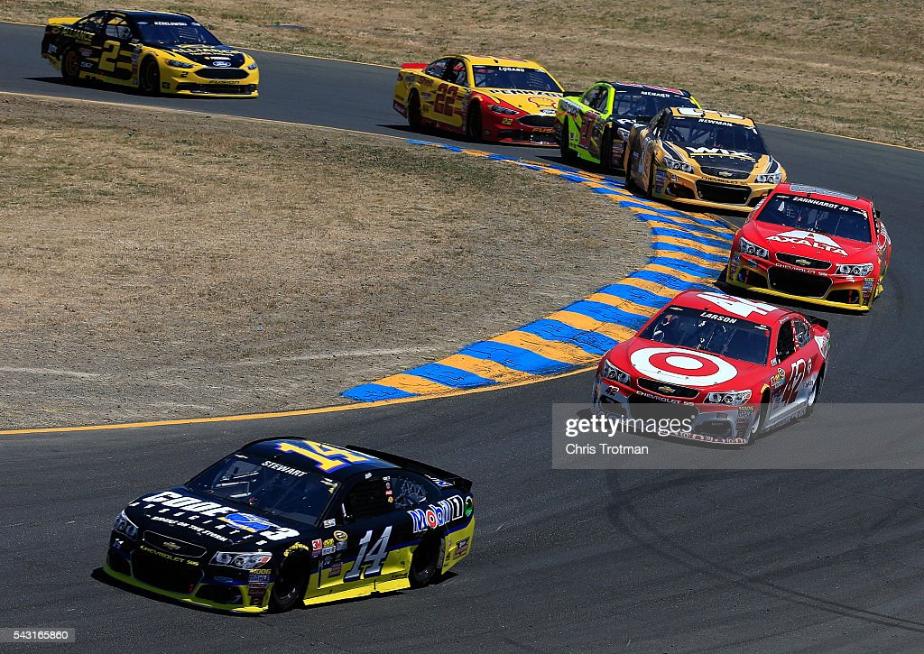 <a gi-track='captionPersonalityLinkClicked' href=/galleries/search?phrase=Tony+Stewart+-+Race+Car+Driver&family=editorial&specificpeople=201686 ng-click='$event.stopPropagation()'>Tony Stewart</a>, driver of the #14 Code 3 Assoc/Mobil 1 Chevrolet, races <a gi-track='captionPersonalityLinkClicked' href=/galleries/search?phrase=Kyle+Larson+-+Race+Car+Driver&family=editorial&specificpeople=2115989 ng-click='$event.stopPropagation()'>Kyle Larson</a>, driver of the #42 Target Chevrolet, during the NASCAR Sprint Cup Series Toyota/Save Mart 350 at Sonoma Raceway on June 26, 2016 in Sonoma, California.