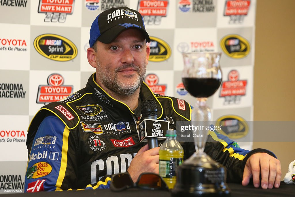 <a gi-track='captionPersonalityLinkClicked' href=/galleries/search?phrase=Tony+Stewart+-+Race+Car+Driver&family=editorial&specificpeople=201686 ng-click='$event.stopPropagation()'>Tony Stewart</a>, driver of the #14 Code 3 Assoc/Mobil 1 Chevrolet, speaks at a press conference following his win in the NASCAR Sprint Cup Series Toyota/Save Mart 350 at Sonoma Raceway on June 26, 2016 in Sonoma, California.