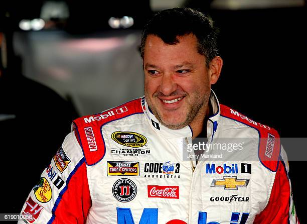 Tony Stewart driver of the Haas Automation Chevrolet looks on during practice for the NASCAR Sprint Cup Series Goody's Fast Relief 500 at...