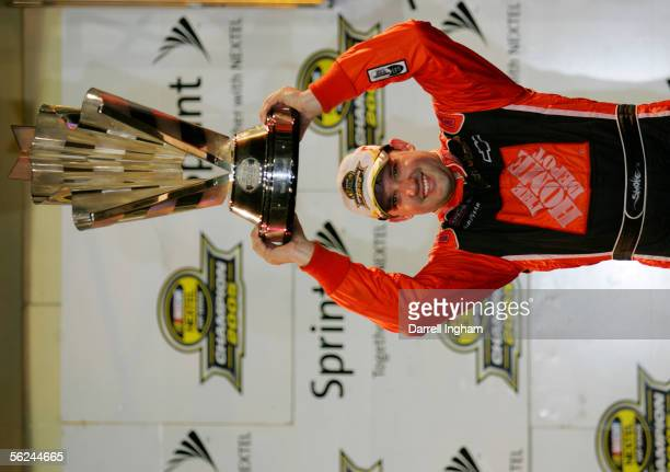 Tony Stewart driver of the Home Depot Chevrolet celebrates winning the championship during the NASCAR Nextel Cup Ford 400 on November 20 2005 at the...