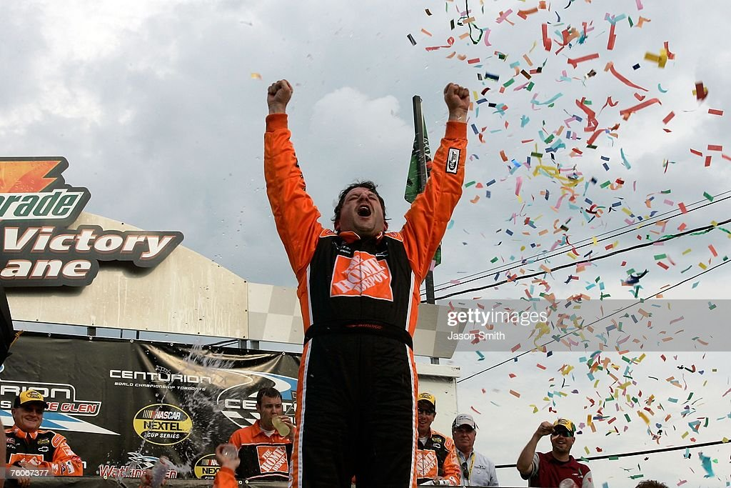 Tony Stewart driver of the Home Depot Chevrolet celebrates with his crew members in victory lane after winning the NASCAR Nextel Cup Series Centurion...