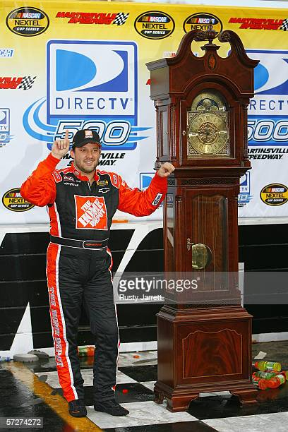 Tony Stewart driver of the Home Depot Chevrolet poses for a photo after winning the NASCAR Nextel Cup Series DirectTV 500 on April 2 2006 at the...