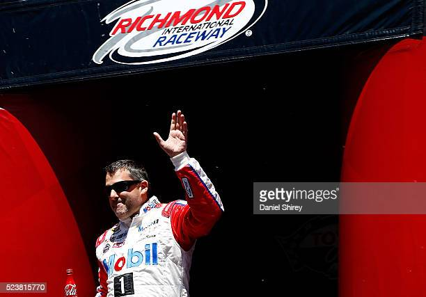 Tony Stewart driver of the Mobil 1 Advanced Fuel Economy Chevrolet is introduced prior to the NASCAR Sprint Cup Series TOYOTA OWNERS 400 at Richmond...