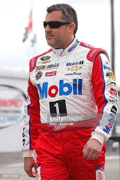 Tony Stewart driver of the Mobil 1 Advanced Fuel Economy Chevrolet prepares to drive during practice for the NASCAR Sprint Cup Series TOYOTA OWNERS...