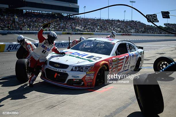 Tony Stewart driver of the Mobil 1 Advanced Fuel Economy Chevrolet pits during the NASCAR Sprint Cup Series TOYOTA OWNERS 400 at Richmond...