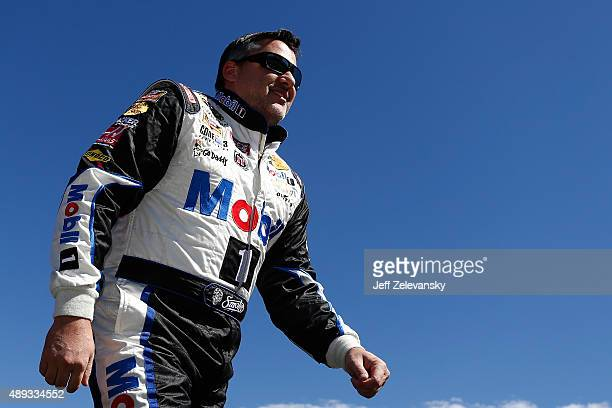 Tony Stewart driver of the Mobil 1 / Bass Pro Shops Chevrolet is introduced during the NASCAR Sprint Cup Series myAFibRiskcom 400 at Chicagoland...