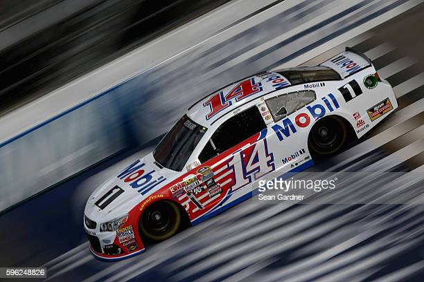 Tony Stewart driver of the Mobil 1 Chevrolet drives during practice for the NASCAR Sprint Cup Series Pure Michigan 400 at Michigan International...