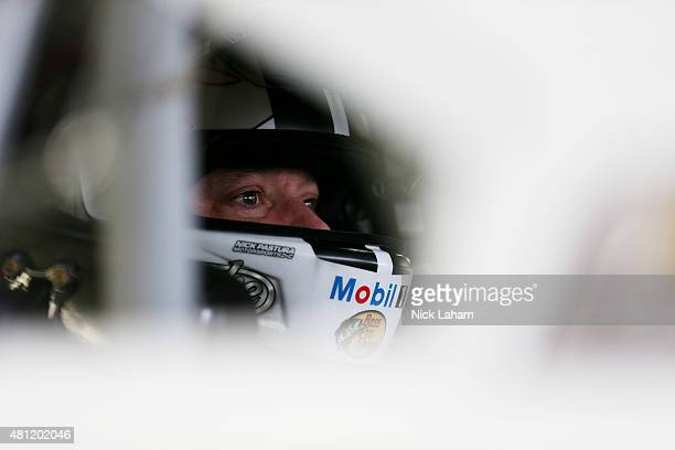 Tony Stewart driver of the Mobil 1 Chevrolet sits in his car during practice for the NASCAR Sprint Cup Series 5Hour Energy 301 at New Hampshire Motor...