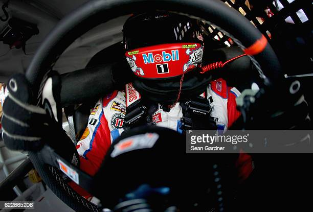 Tony Stewart driver of the Mobil 1 Chevrolet sits in his car during practice for the NASCAR Sprint Cup Series CanAm 500 at Phoenix International...