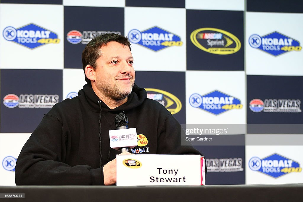 <a gi-track='captionPersonalityLinkClicked' href=/galleries/search?phrase=Tony+Stewart+-+Race+Car+Driver&family=editorial&specificpeople=201686 ng-click='$event.stopPropagation()'>Tony Stewart</a>, driver of the #14 Mobil 1 Racing/Bass Pro Shops Chevrolet, speaks to the media during a rain delay of practice for the NASCAR Sprint Cup Series at Las Vegas Motor Speedway on March 8, 2013 in Las Vegas, Nevada.