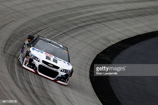 Tony Stewart driver of the Mobil 1/Bass Pro Shops Chevrolet drives during practice for the NASCAR Sprint Cup Series AAA 400 at Dover International...