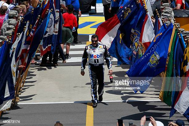 Tony Stewart driver of the Mobil 1/Bass Pro Shops Chevrolet greets fans during the NASCAR Sprint Cup Series Axalta 'We Paint Winners' 400 at Pocono...