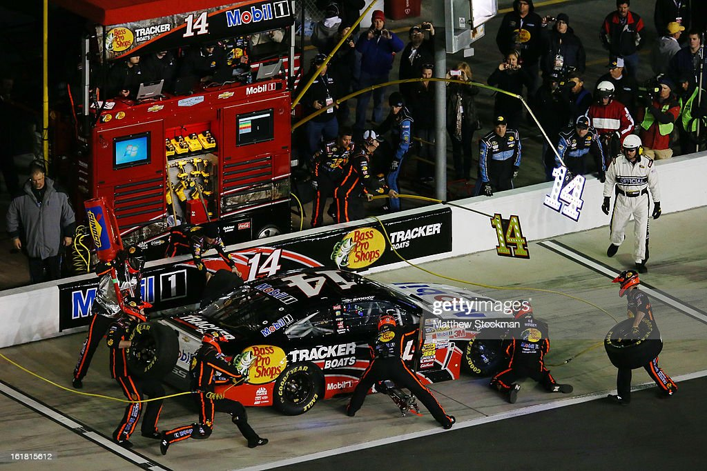 Tony Stewart, driver of the #14 Mobil 1/Bass Pro Shops Chevrolet, makes a pit stop during the NASCAR Sprint Cup Series Sprint Unlimited at Daytona International Speedway on February 16, 2013 in Daytona Beach, Florida.