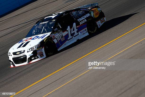Tony Stewart driver of the Mobil 1/Bass Pro Shops Chevrolet practices for the NASCAR Sprint Cup Series Quicken Loans Race for Heroes 500 at Phoenix...