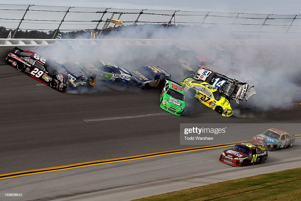 <a gi-track='captionPersonalityLinkClicked' href=/galleries/search?phrase=Tony+Stewart+-+Race+Car+Driver&family=editorial&specificpeople=201686 ng-click='$event.stopPropagation()'>Tony Stewart</a>, driver of the #14 Mobil 1/Office Depot Chevrolet, flips in the air after and incident with the field in the final lap of the NASCAR Sprint Cup Series Good Sam Roadside Assistance 500 at Talladega Superspeedway on October 7, 2012 in Talladega, Alabama.