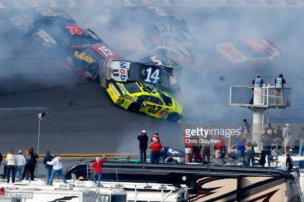 Tony Stewart driver of the Mobil 1/Office Depot Chevrolet flips in the air after an incident with the field in the final lap of the NASCAR Sprint Cup...