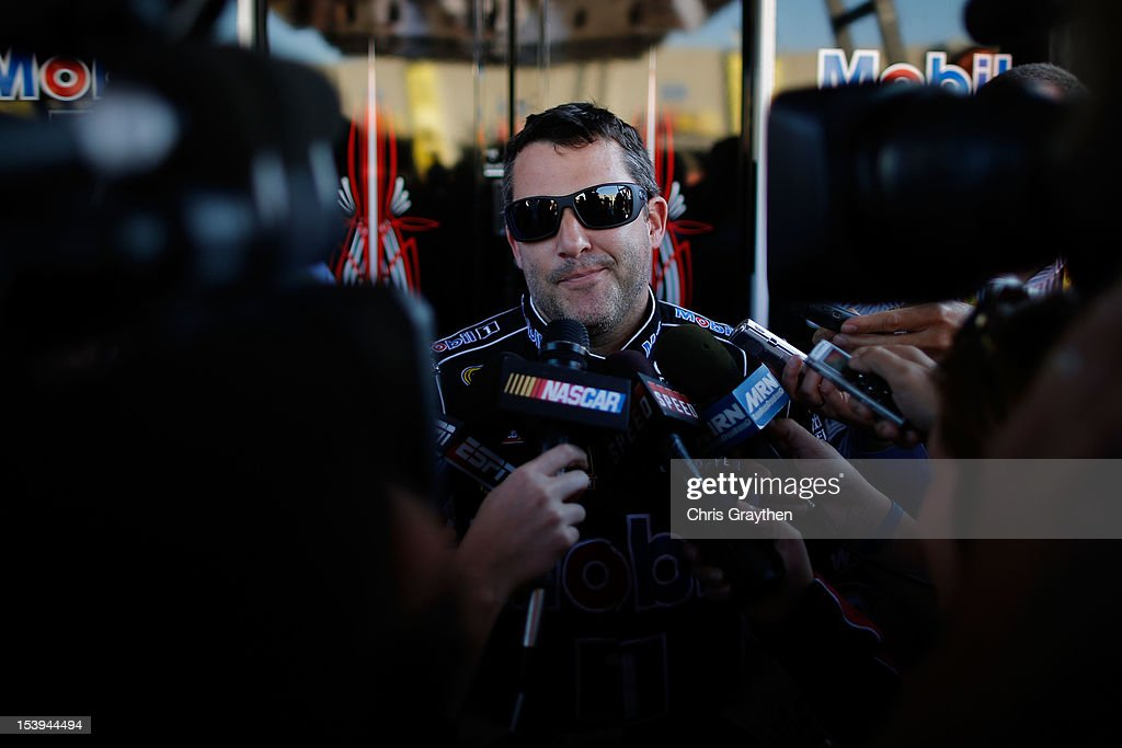 <a gi-track='captionPersonalityLinkClicked' href=/galleries/search?phrase=Tony+Stewart+-+Race+Car+Driver&family=editorial&specificpeople=201686 ng-click='$event.stopPropagation()'>Tony Stewart</a>, driver of the #14 Mobil 1/Office Depot Chevrolet, is interviewed in the garage area during practice for the NASCAR Sprint Cup Series Bank of America 500 at Charlotte Motor Speedway on October 11, 2012 in Charlotte, North Carolina.