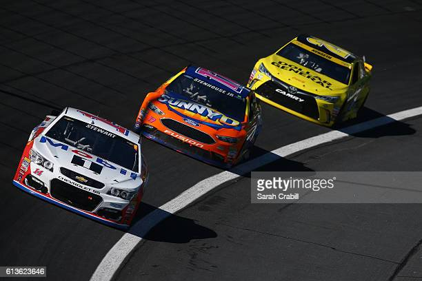 Tony Stewart driver of the Mobil 1/Rev the Vote Chevrolet leads a pack of cars during the NASCAR Sprint Cup Series Bank of America 500 at Charlotte...