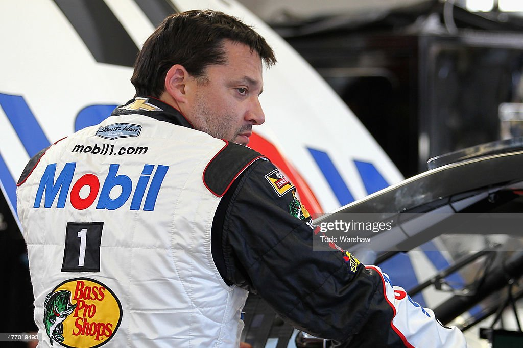 <a gi-track='captionPersonalityLinkClicked' href=/galleries/search?phrase=Tony+Stewart+-+Race+Car+Driver&family=editorial&specificpeople=201686 ng-click='$event.stopPropagation()'>Tony Stewart</a>, driver of the #14 Mobil1/Bass Pro Shops Chevrolet, stands in the garage during a testing session at Las Vegas Motor Speedway on March 6, 2014 in Las Vegas, Nevada.