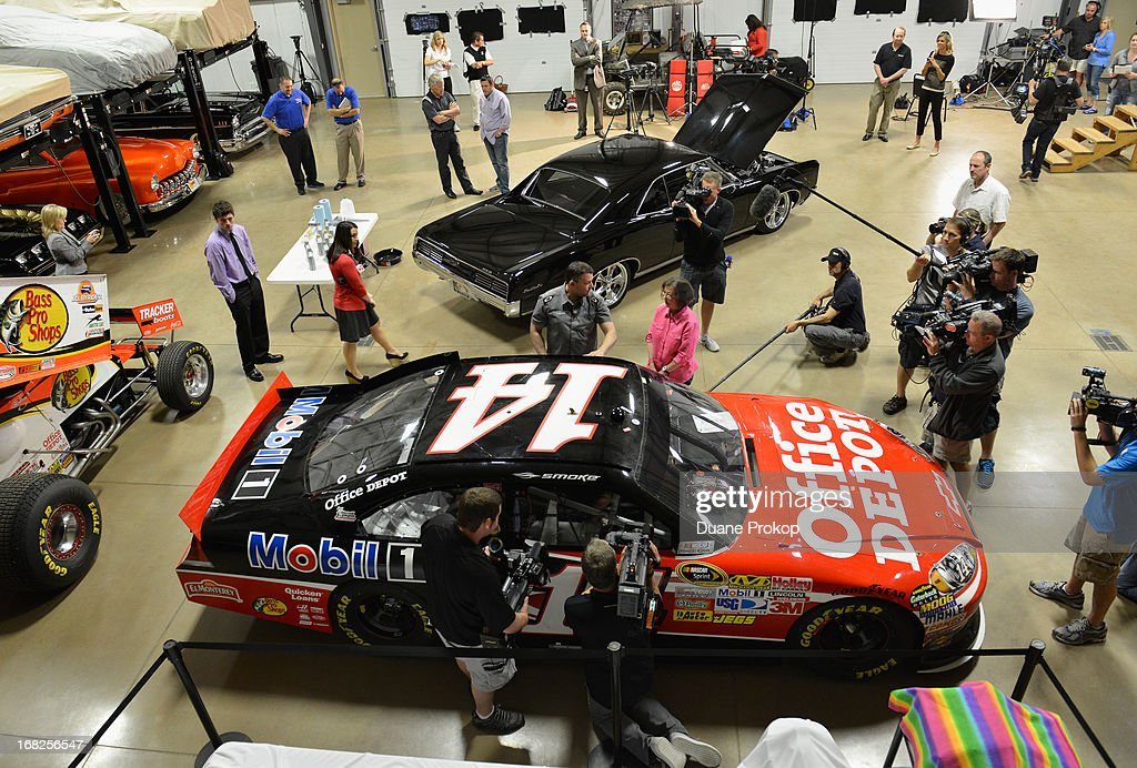 <a gi-track='captionPersonalityLinkClicked' href=/galleries/search?phrase=Tony+Stewart+-+Race+Car+Driver&family=editorial&specificpeople=201686 ng-click='$event.stopPropagation()'>Tony Stewart</a>, driver of the No. 14 Mobil 1/Bass Pro Shops Chevrolet SS, shows off his 2011 NASCAR Sprint Cup Championship car at his personal garage in Columbus, Ind. Sandra Clark, from LaGrange, Ga., won the chance to meet Smoke and tour his personal classic car collection through the Under the Hood with Tony and Mobil 1 sweepstakes.