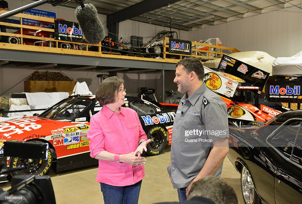 <a gi-track='captionPersonalityLinkClicked' href=/galleries/search?phrase=Tony+Stewart+-+Race+Car+Driver&family=editorial&specificpeople=201686 ng-click='$event.stopPropagation()'>Tony Stewart</a>, driver of the No. 14 Mobil 1/Bass Pro Shops Chevrolet SS, talks with fan Sandra Clark at his personal garage in Columbus, Ind. Clark, from LaGrange, Ga., won the chance to meet Smoke and tour his personal classic car collection through the Under the Hood with Tony and Mobil 1 sweepstakes.
