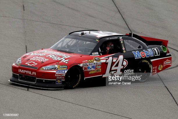 Tony Stewart driver of the Office Depot/Mobil 1 Chevrolet celebrates after winning the NASCAR Sprint Cup Series GEICO 400 at Chicagoland Speedway on...