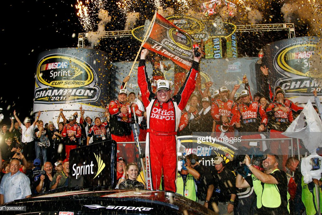 Tony Stewart, driver of the #14 Office Depot/Mobil 1 Chevrolet, celebrates in Victory Lane after winning the NASCAR Sprint Cup Series Ford 400 and the 2011 Series Championship at Homestead-Miami Speedway on November 20, 2011 in Homestead, Florida. Stewart wins his third NASCAR Championship.