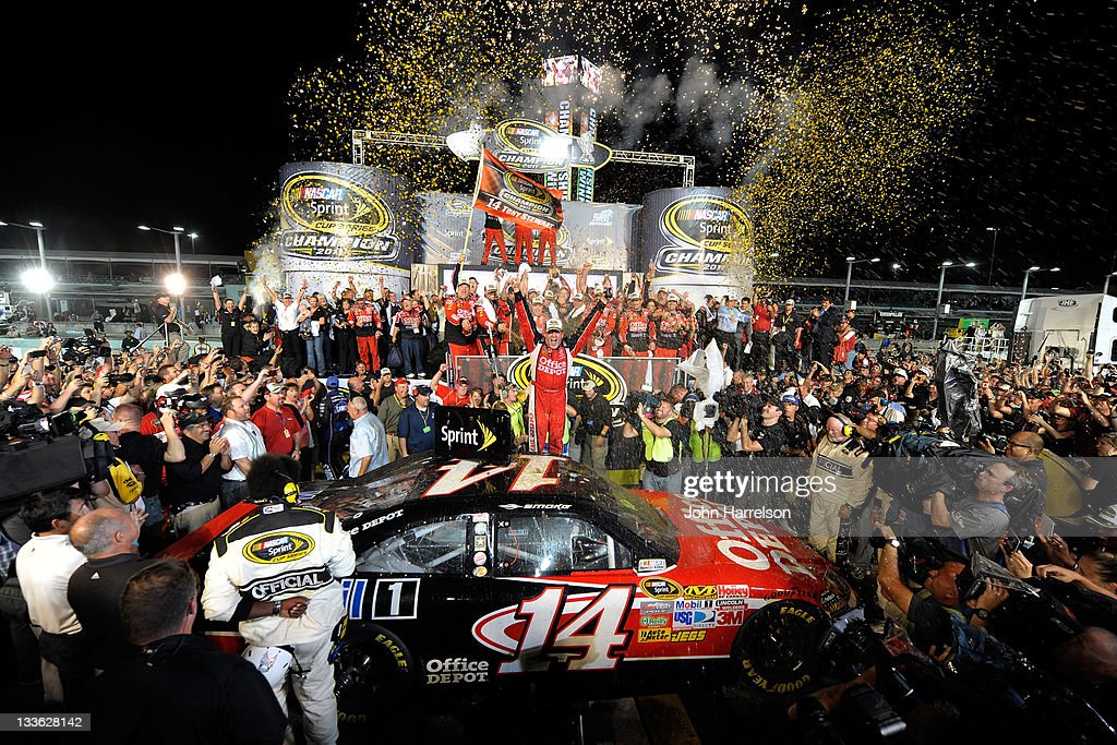 <a gi-track='captionPersonalityLinkClicked' href=/galleries/search?phrase=Tony+Stewart+-+Race+Car+Driver&family=editorial&specificpeople=201686 ng-click='$event.stopPropagation()'>Tony Stewart</a>, driver of the #14 Office Depot/Mobil 1 Chevrolet, celebrates in Victory Lane after winning the NASCAR Sprint Cup Series Ford 400 and the 2011 Series Championship at Homestead-Miami Speedway on November 20, 2011 in Homestead, Florida. Stewart wins his third NASCAR Championship.