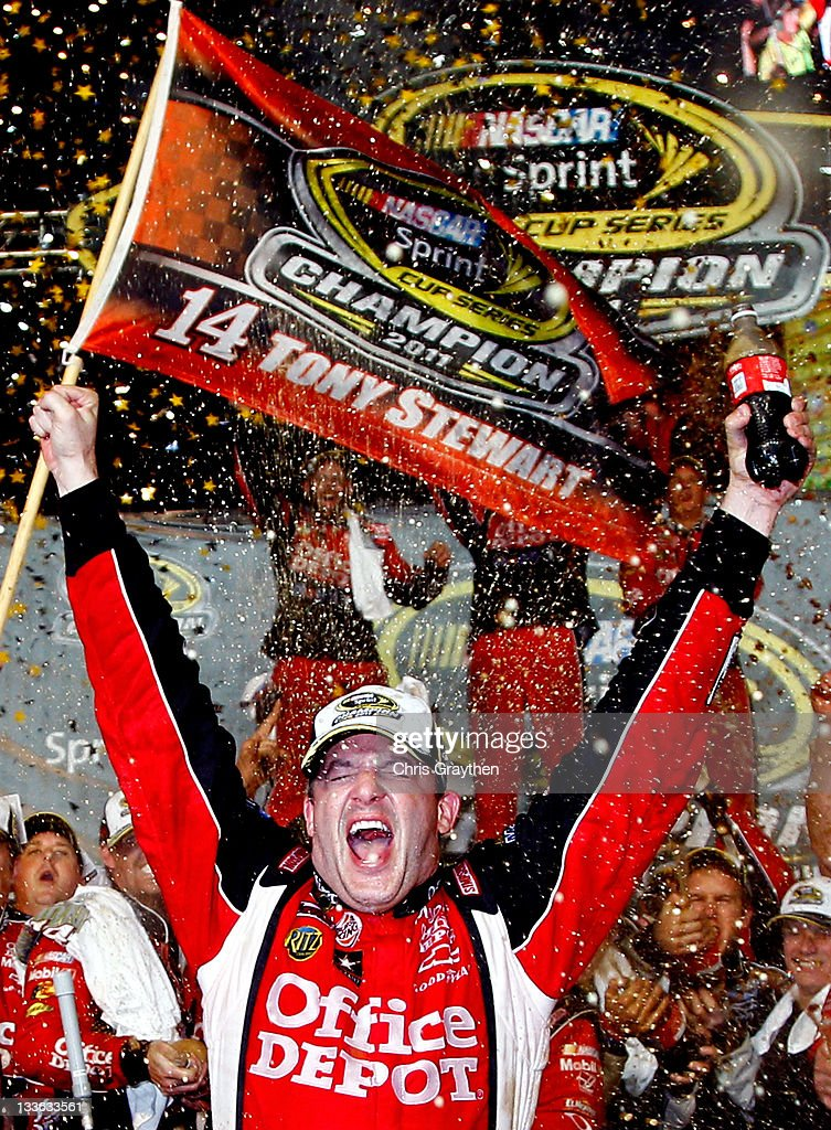 <a gi-track='captionPersonalityLinkClicked' href=/galleries/search?phrase=Tony+Stewart+-+Race+Car+Driver&family=editorial&specificpeople=201686 ng-click='$event.stopPropagation()'>Tony Stewart</a>, driver of the #14 Office Depot/Mobil 1 Chevrolet, celebrates after winning the NASCAR Sprint Cup Series Ford 400 and the 2011 Series Championship at Homestead-Miami Speedway on November 20, 2011 in Homestead, Florida. Stewart wins his third NASCAR Championship.