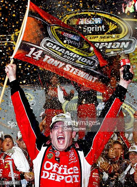 Tony Stewart driver of the Office Depot/Mobil 1 Chevrolet celebrates after winning the NASCAR Sprint Cup Series Ford 400 and the 2011 Series...