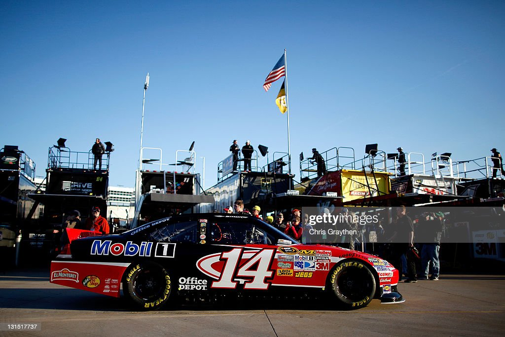 <a gi-track='captionPersonalityLinkClicked' href=/galleries/search?phrase=Tony+Stewart+-+Piloto+de+automobilismo&family=editorial&specificpeople=201686 ng-click='$event.stopPropagation()'>Tony Stewart</a>, driver of the #14 Office Depot/Mobil 1 Chevrolet, drives through the garage area during practice for the NASCAR Sprint Cup Series AAA Texas 500 at Texas Motor Speedway on November 5, 2011 in Fort Worth, Texas.