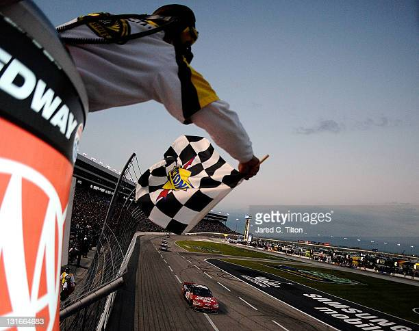 Tony Stewart driver of the Office Depot/Mobil 1 Chevrolet heads towards the start finish line to take the sunoco checkered flag and win the NASCAR...