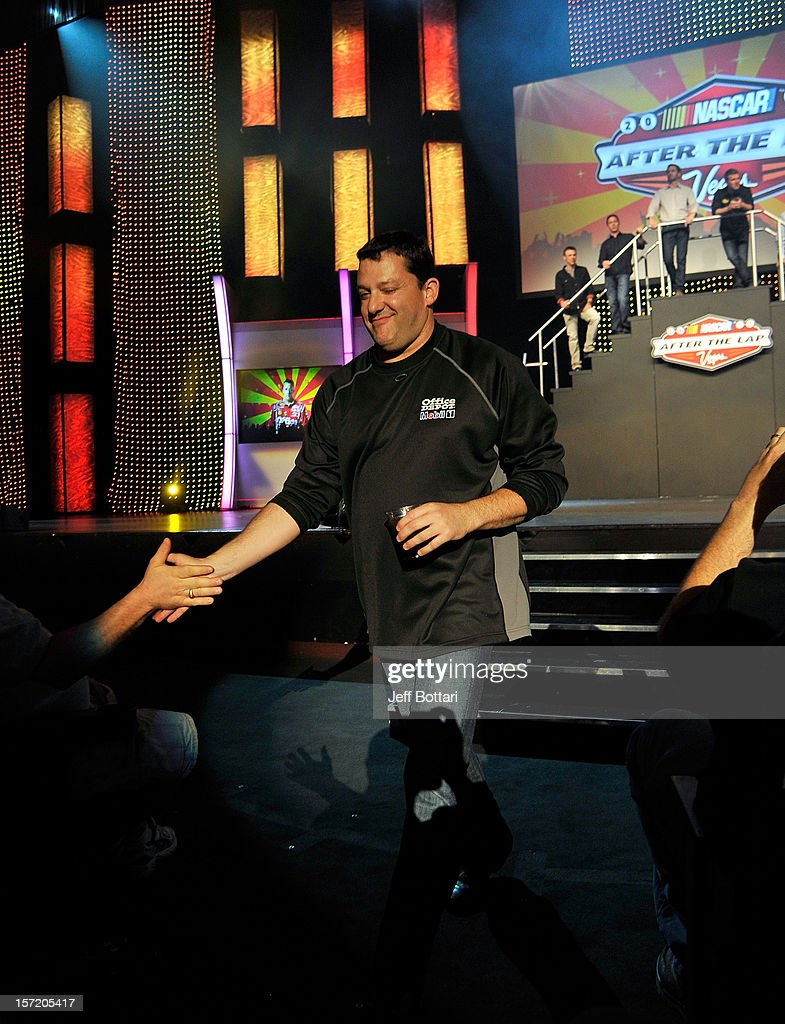 Tony Stewart, driver of the #14 Office Depot/Mobil 1 Chevrolet, high-fives fans during NASCAR After The Lap at PH Live at Planet Hollywood Resort & Casino on November 29, 2012 in Las Vegas, Nevada.