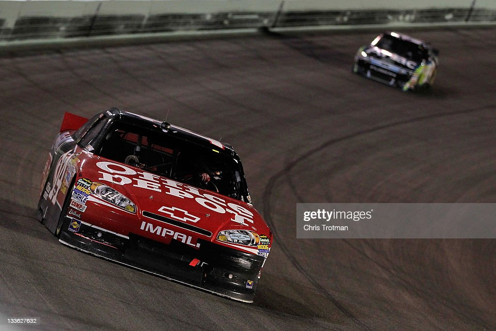 <a gi-track='captionPersonalityLinkClicked' href=/galleries/search?phrase=Tony+Stewart+-+Race+Car+Driver&family=editorial&specificpeople=201686 ng-click='$event.stopPropagation()'>Tony Stewart</a>, driver of the #14 Office Depot/Mobil 1 Chevrolet, leads <a gi-track='captionPersonalityLinkClicked' href=/galleries/search?phrase=Carl+Edwards&family=editorial&specificpeople=193803 ng-click='$event.stopPropagation()'>Carl Edwards</a>, driver of the #99 Aflac Ford, during the NASCAR Sprint Cup Series Ford 400 at Homestead-Miami Speedway on November 20, 2011 in Homestead, Florida.