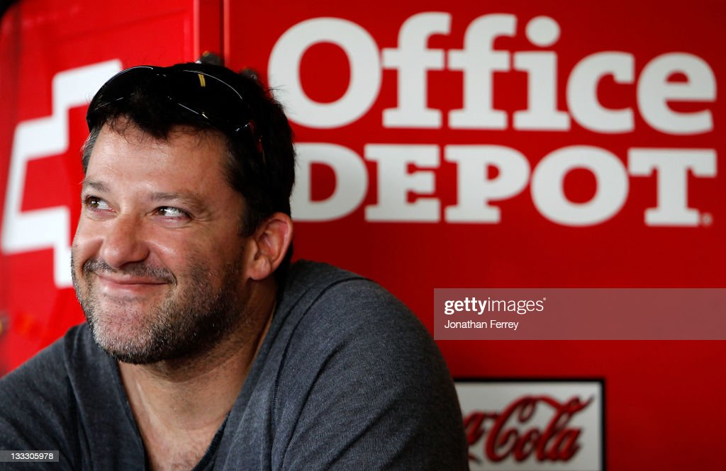 <a gi-track='captionPersonalityLinkClicked' href=/galleries/search?phrase=Tony+Stewart+-+Racerf%C3%B6rare&family=editorial&specificpeople=201686 ng-click='$event.stopPropagation()'>Tony Stewart</a>, driver of the #14 Office Depot/Mobil 1 Chevrolet, smiles from inside the garage during practice for the NASCAR Sprint Cup Series Ford 400 at Homestead-Miami Speedway on November 18, 2011 in Homestead, Florida.