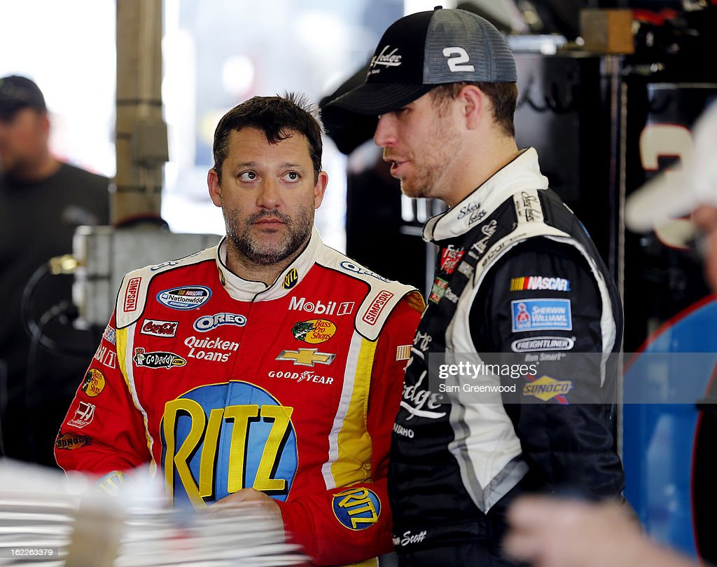 <a gi-track='captionPersonalityLinkClicked' href=/galleries/search?phrase=Tony+Stewart+-+Race+Car+Driver&family=editorial&specificpeople=201686 ng-click='$event.stopPropagation()'>Tony Stewart</a> (L), driver of the #33 Oreo/Ritz Chevrolet, talks Brian Scott (R), driver of the #2 Shore Lodge Chevrolet, in the garage during practice for the NASCAR Nationwide Series DRIVE4COPD 300 at Daytona International Speedway on February 21, 2013 in Daytona Beach, Florida.