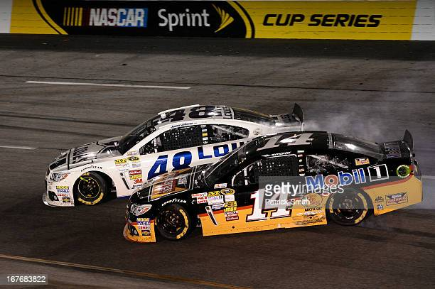 Tony Stewart driver of the Rush Truck Centers/Mobil 1 Chevrolet and Jimmie Johnson driver of the Lowe's Dover White Chevrolet spin out after an...