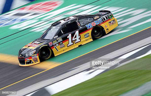 Tony Stewart driver of the Rush Truck Centers/Mobil 1 Chevrolet practices for the NASCAR Sprint Cup Series Quaker State 400 at Kentucky Speedway on...
