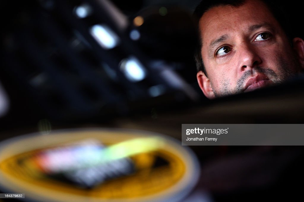 <a gi-track='captionPersonalityLinkClicked' href=/galleries/search?phrase=Tony+Stewart+-+Race+Car+Driver&family=editorial&specificpeople=201686 ng-click='$event.stopPropagation()'>Tony Stewart</a>, driver of the #14 Rush Truck Centers/Mobil 1 Chevrolet, sits in his car during practice for the NASCAR Sprint Cup Series Auto Club 400 at Auto Club Speedway on March 23, 2013 in Fontana, California.