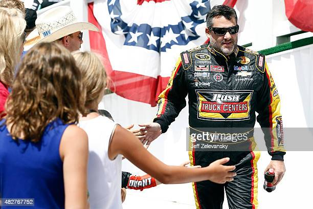 Tony Stewart driver of the Rush Truck Centers/Mobil 1 Chevrolet takes part in prerace ceremonies for the NASCAR Sprint Cup Series Windows 10 400 at...