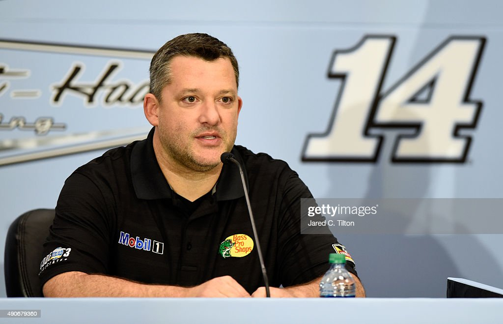 Tony Stewart driver of the StewartHaas Racing Chevrolet and coowner of StewartHaas Racing speaks with the media during a press conference announcing...